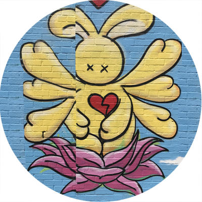 A rabbit-like creature emerging from a lotus flower to symbolize community and resilience.
