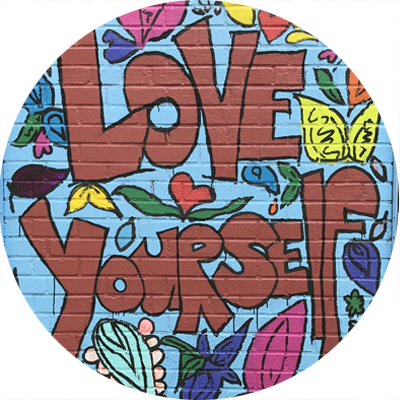 "The words ""Love Yourself"" styled in a 60s flower power design. From PS9's exterior mural."
